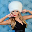 Beautiful woman in white fur hat — Stock Photo #11422081