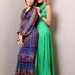 Two beautiful woman posing in a fancy dresses — Stock Photo