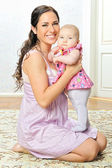 Beautiful mother with her newborn baby. — Stock Photo