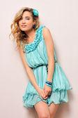 Beautiful blonde in blue dress, — Stock Photo