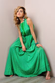 Portrait of the beautiful woman in a long green dress. — Stock Photo