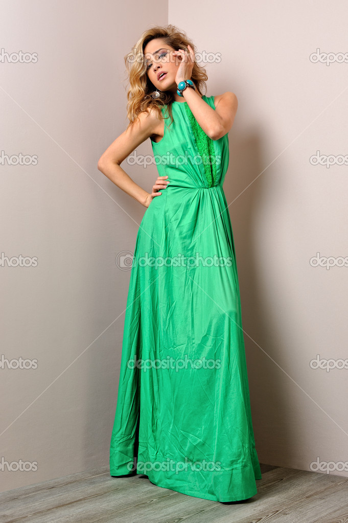 Portrait of the beautiful woman in a long green dress. Studio photoshoot.  Stock Photo #11422128