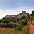 Morella in Spain. Landscape with rural road with castle and town — Stockfoto