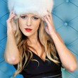 Beautiful woman in white fur hat — Stock Photo #11834076