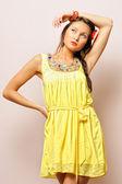 Beautiful woman in yellow dress — Stock Photo