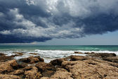 Sea landscape with rocky coast and storm sky . — Stock Photo