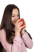 Portrait of a beautiful girl with a cup of coffee in hand — Stock Photo