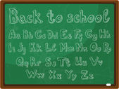 Back to school - the school board with the handwritten alphabet — Stock Vector