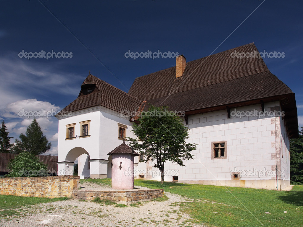 Manor house in open-air museum of Liptov village Pribylina, Slovakia. The view portraits manor house saved from village Parizovce. It is one of the most valuable historical buildings and rare example of the old-time noble residence in Liptov region. — Stock Photo #11400135