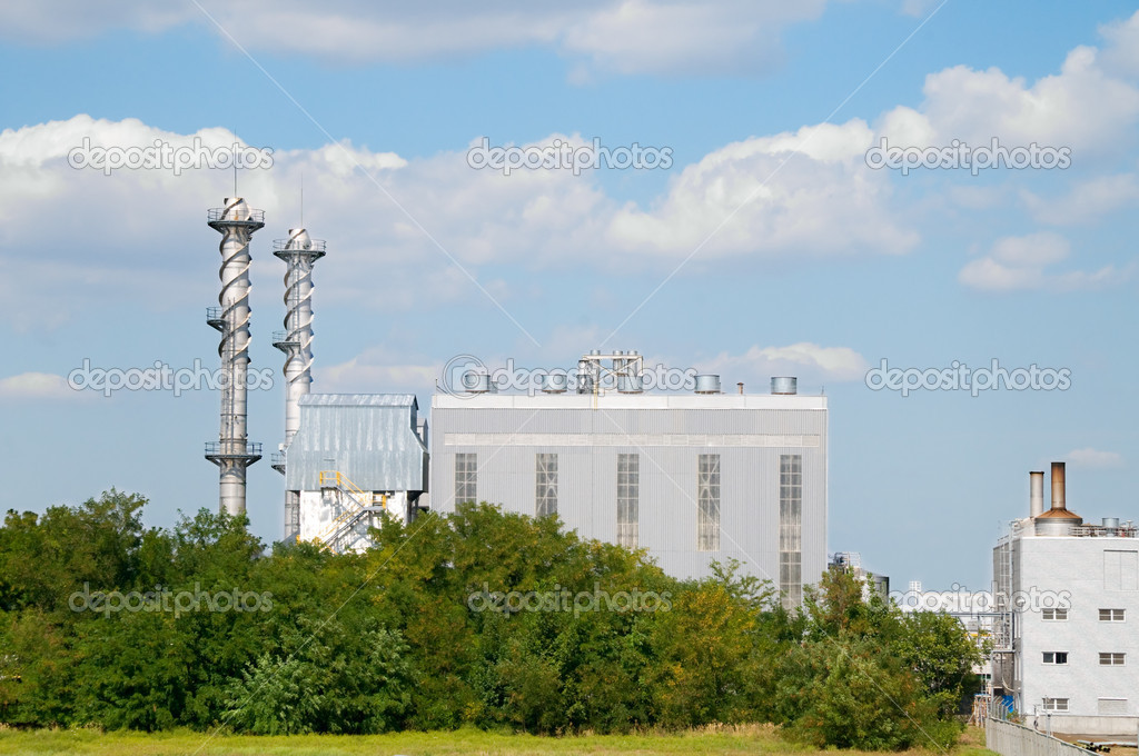 Factory pipes and building on a background of the blue sky with clouds — Stock Photo #10835613