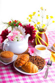 Breakfest with tea, cake and yellow flowers — Stock Photo