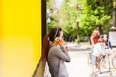 Teenager oriental girl on yellow wal — Stock Photo