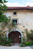 Flowers pots in the facade house — Stock Photo