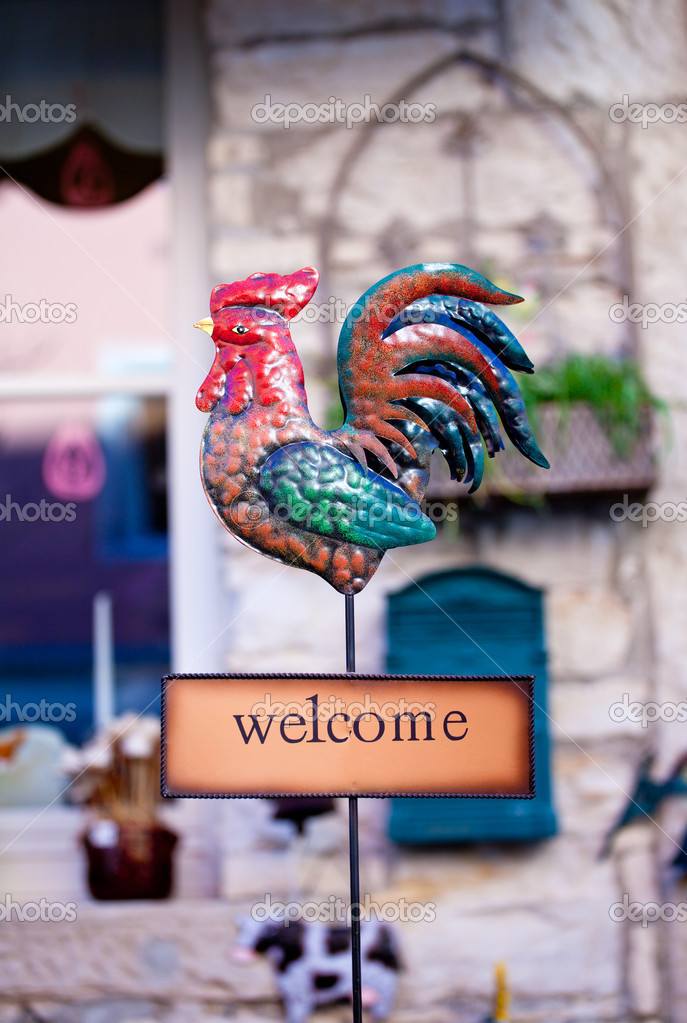View of Welcome sign with iron rooster — Stok fotoğraf #12233707