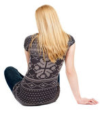 Back view of beautiful young woman sitting on the floor — Stock Photo