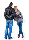 Back view of young couple (man and woman) look into the distance — Stock Photo