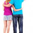 Back view of young couple pointing at wall — Stockfoto