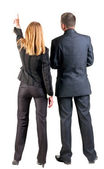 Back view of pointing business team. — Stock Photo