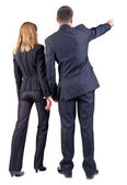 Back view of pointing business team — Stock Photo