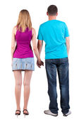 Back view of young embracing couple — Stock Photo
