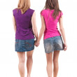 Back view going of two young girl (brunette and blonde) - Foto Stock