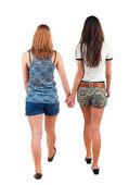 Va de vista trasera de dos mujeres — Foto de Stock