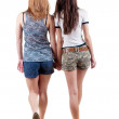 Back view going of two young woman — Stock Photo