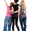 Back view of group young women pointing . - Foto Stock