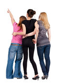Back view of group young women pointing . — Photo