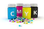Medical capsules of CMYK colors — Stock Photo