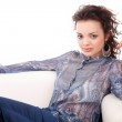 Young woman relaxing on couch — Stock Photo #11229010