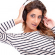 Young woman listening to music — Stock Photo #11229433