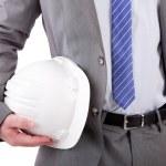 Detail of an engineer holding an helmet — Stock Photo #11229881