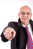 Mature business man pointing forward — Stock Photo