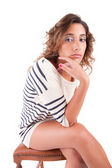 Beautiful brunette sitting on a chair — Stock Photo