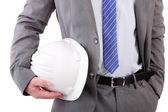 Detail of an engineer holding an helmet — Stock Photo