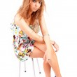 Beautiful woman sitting on a chair — Stock Photo #11230301