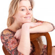 Beautiful woman sitting on a chair — Stock Photo