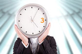 Business woman holding a clock — Stock Photo