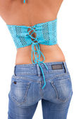 Torso of a beautiful woman in jeans — Stock Photo
