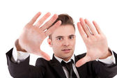 Business man showing framing hand gesture — Stock Photo