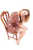Beautiful woman sitting on a chair — Stock Photo
