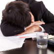 Business man sleeping over the desk — Stock Photo