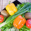 Stock Photo: Varicoloured fruit and vegetables lie on dish