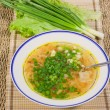 Stock Photo: Hot soup with spring onions on decorative napkin