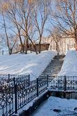 Bridge through a channel in a winter park, city Perm — Stock Photo