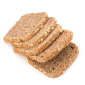Healthy bran bread slices with rolled oats — Stock Photo