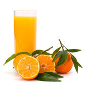 Tangerines and juice glass — Stock Photo