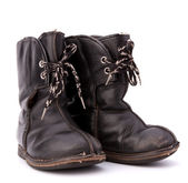 Vintage shabby child's boots — Stock Photo