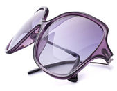 Stylish female sunglasses — Stock Photo
